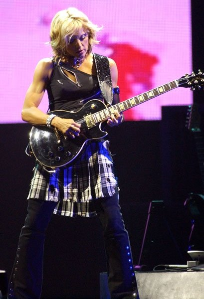 Madonna with her Gibson Les Paul playing CPG